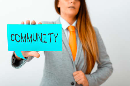 Conceptual hand writing showing Community. Concept meaning group of showing with a common characteristics living together Displaying different color notes for emphasizing content Banque d'images