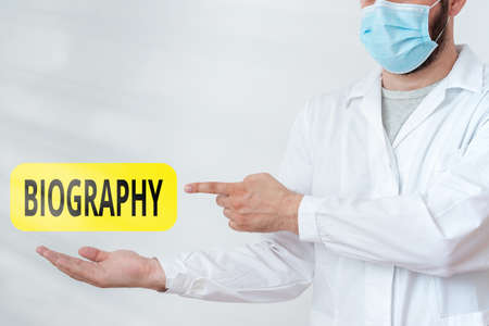 Word writing text Biography. Business photo showcasing an account of the life of something such as an animal, a coin, etc. Displaying Empty Sticker Paper Accessories Smartphone With Medical Gloves On Standard-Bild