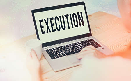 Conceptual hand writing showing Execution. Concept meaning the carrying out or putting effect of plan, or course of action Modern gadgets white screen under colorful bokeh background