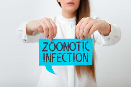 Conceptual hand writing showing Zoonotic Infection. Concept meaning communicable disease transmitted by a non viral agent Displaying different color notes for emphasizing content Banco de Imagens