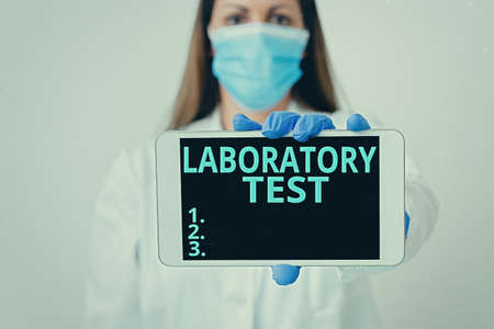 Writing note showing Laboratory Test. Business concept for Determination of a medical diagnosis from the substances tested Laboratory technician featuring empty paper accessories smartphone
