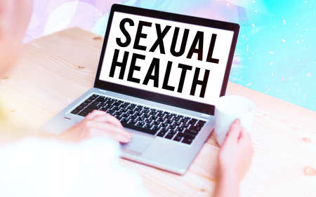 Word writing text Sexual Health. Business photo showcasing Ability to embrace and enjoy sexuality throughout our lives Modern gadgets with white display screen under colorful bokeh background