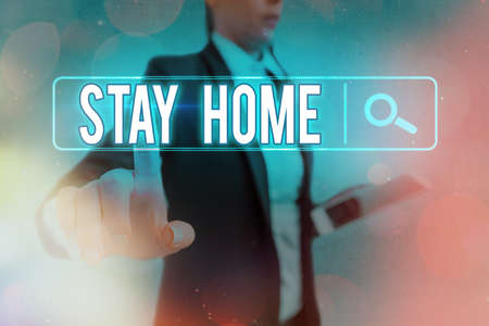 Conceptual hand writing showing Stay Home. Concept meaning not go out for an activity and stay inside the house or home Web search digital futuristic technology network connection Banco de Imagens