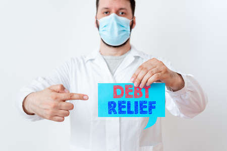 Text sign showing Debt Relief. Business photo showcasing partial or total remission of it especially those by countries Laboratory Technician Featuring Empty Sticker Paper Accessories Smartphone