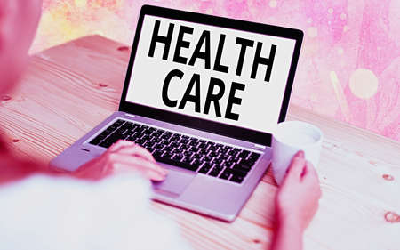 Text sign showing Health Care. Business photo showcasing organized provision of medical care to individuals or community Modern gadgets with white display screen under colorful bokeh background Banco de Imagens