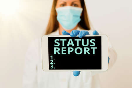 Writing note showing Status Report. Business concept for summarizes the particular situation as of a stated period Laboratory technician featuring empty paper accessories smartphone