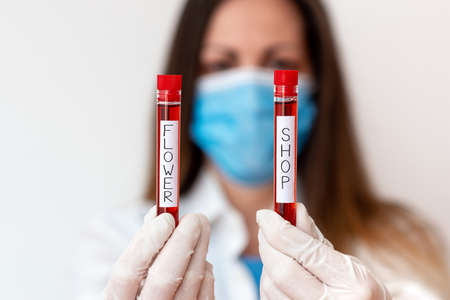 Handwriting text Flower Shop. Conceptual photo where cut flowers are sold with decorations for gifts Laboratory blood test sample shown for medical diagnostic analysis result
