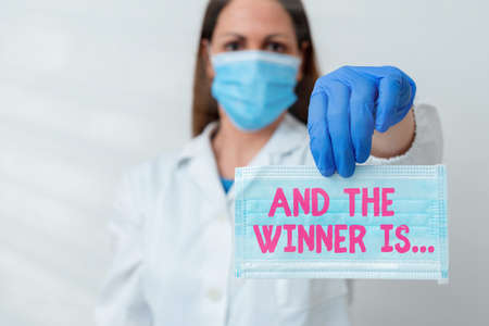 Conceptual hand writing showing And The Winner Is. Concept meaning announcing an individual or thing that wins something Laboratory blood test sample for medical diagnostic analysis Banco de Imagens