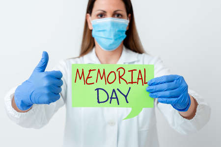 Word writing text Memorial Day. Business photo showcasing To honor and remembering those who died in military service Laboratory technician featuring empty sticker paper accessories smartphone 写真素材