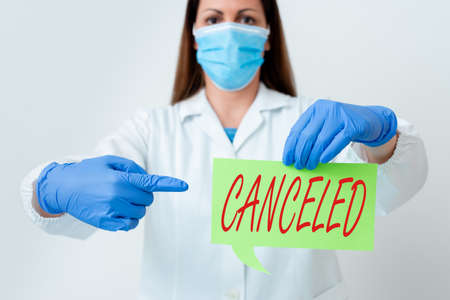 Text sign showing Canceled. Business photo text to decide not to conduct or perform something planned or expected Laboratory technician featuring empty sticker paper accessories smartphone Banco de Imagens