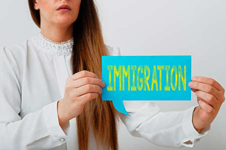 Writing note showing Immigration. Business concept for the action of coming to live permanently in a foreign country Displaying different color mock up notes for emphasizing content