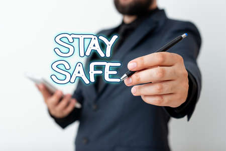 Text sign showing Stay Safe. Business photo text secure from threat of danger, harm or place to keep articles Model displaying different shots of holding pen ready for promotional use