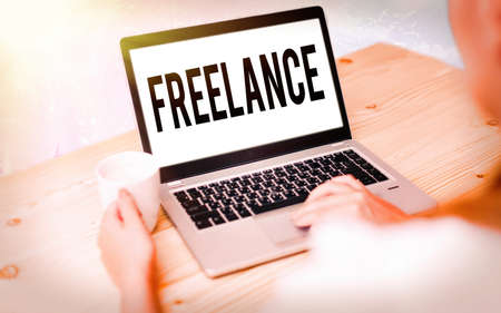 Conceptual hand writing showing Freelance. Concept meaning an individual who pursues a profession without a longterm commitment Modern gadgets white screen under colorful bokeh background