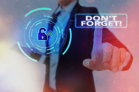Conceptual hand writing showing Don T Forget. Concept meaning used to remind someone about an important fact or detail Graphics padlock for web data security application system