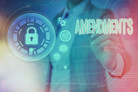 Writing note showing Amendments. Business concept for process of amending a law or document by parliamentary. Graphics padlock for web data information security application system