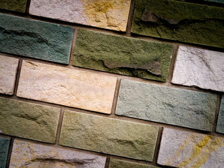 faade: close up of old dark stone wall or surface. background and texture concept