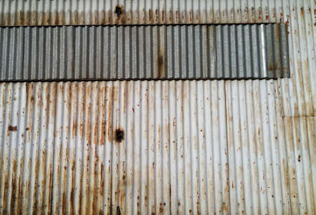 background made of corrugated metal sheets, industrial wall