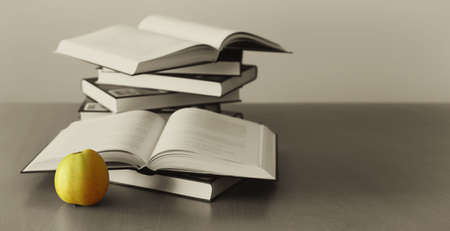 green apple and books background Standard-Bild