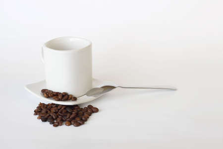coffee mug, spoon and spilled coffee on white background Stock Photo - 6911645