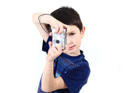 small boy photographing vertical with digital camera on white background
