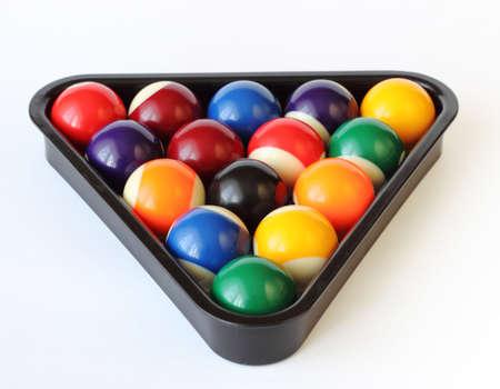 colored backgound: Brightly colored pool or billiard balls on white backgound