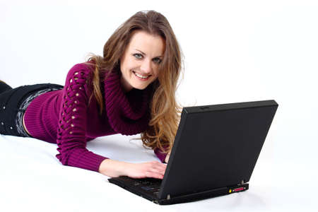 lying and smiling attractive woman with a laptop with white background photo