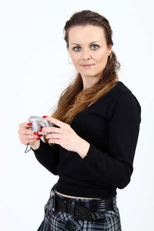 The attractive woman with digital camera  on white background  Stock Photo - 6877898
