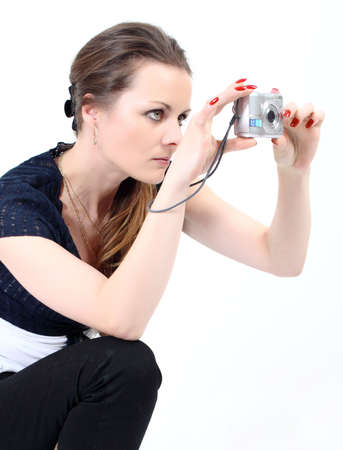The attractive woman making photo with digital camera on white background Stock Photo - 6877900