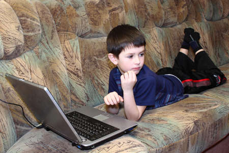 small boy with notebook at home