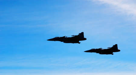 Two aircraft Jas 39 Gripen on blue sky Stock Photo - 7032102