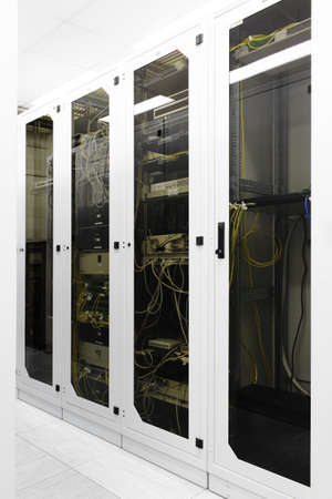 Racks with network equipment in technology telehouse room photo