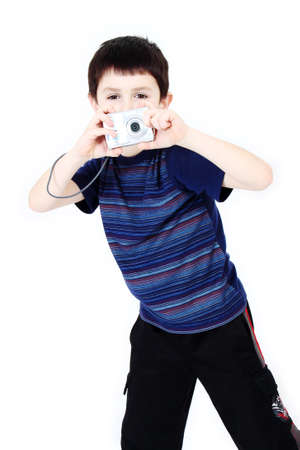 Young boy with digital camera prepare for shooting photo