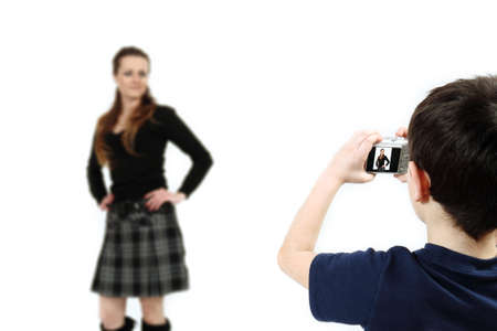 Young boy with digital camera prepare for shooting mother photo