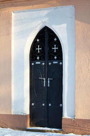 chappel: detail of door to Small chappel in sunny day Stock Photo