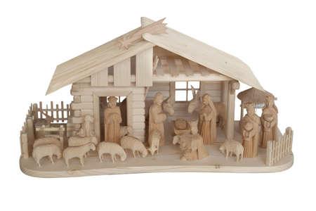 Nativity Scene made of wood, isolated on white photo