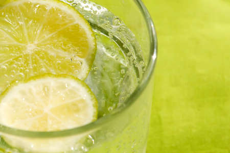 Glass of sparkling water and lemon refreshment for background photo