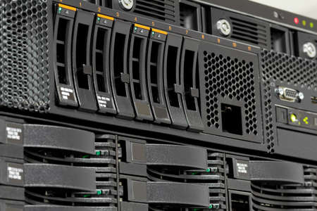 servers stack with hard drives in a datacenter for backup and data storage