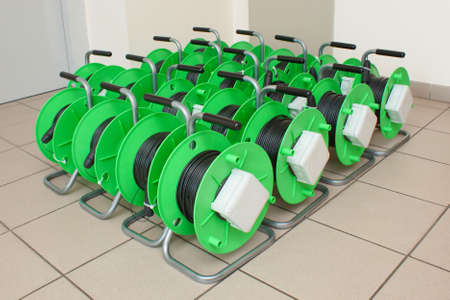 Group of green cable reels for new fiber optic installation