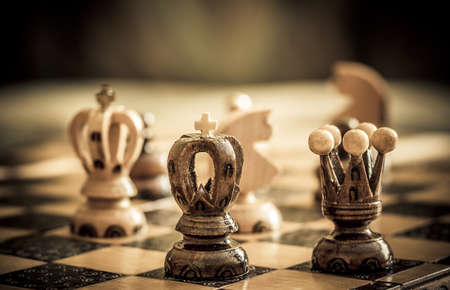 chess with focus to black king and queen photo