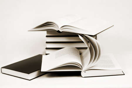 guidebook: composition of bw books toned to sepia on white background Stock Photo