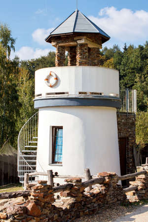small lighthouse for childs play in park photo