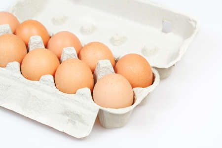 Fresh eggs in carton box on white background Stock Photo - 12678237