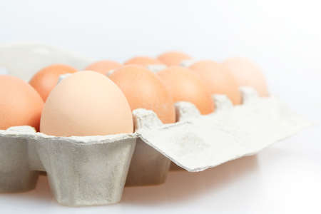 Fresh eggs in carton box on white background Stock Photo - 12678209