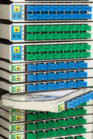 fiber optic cable management system with green and blue SC connectors photo