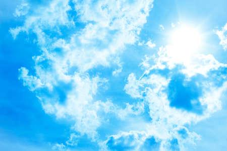 ばねまたは夏の太陽と雲と青い空 写真素材