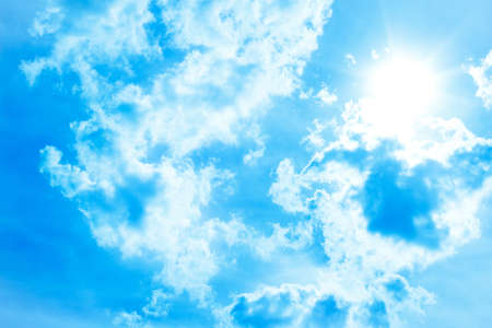 Blue sky with clouds and spring or summer sun
