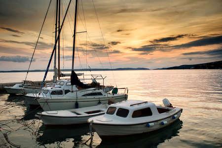 Fishing boats in Adriatic sea old town in Croatia popular tourist destination photo