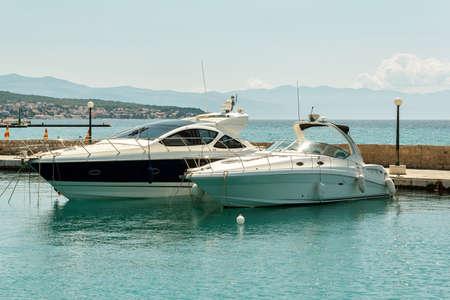 two luxury yachts on pier in croatian sea Stock Photo