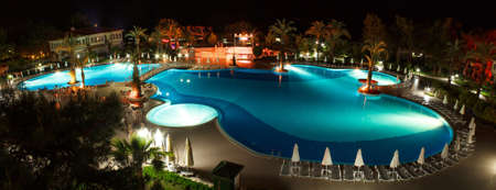 hotel balcony: luxury hotels pool at night in turkey Editorial