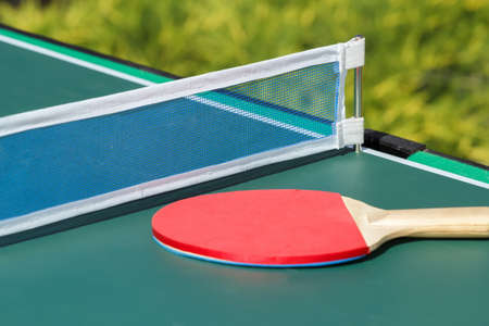 ping pong: small child table tennis or ping pong in garden